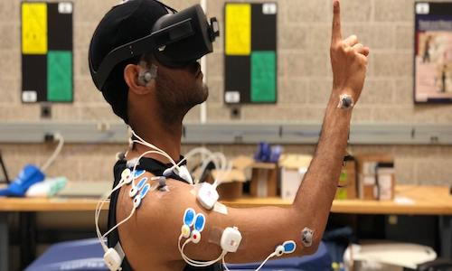 A VR player has sensors placed on joints and  muscles so researchers can use motion capture to record their movements while performing common VR gestures.